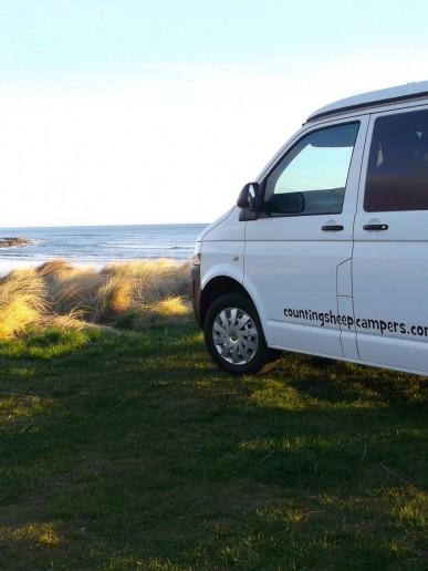 Van and beach view campervan scotland