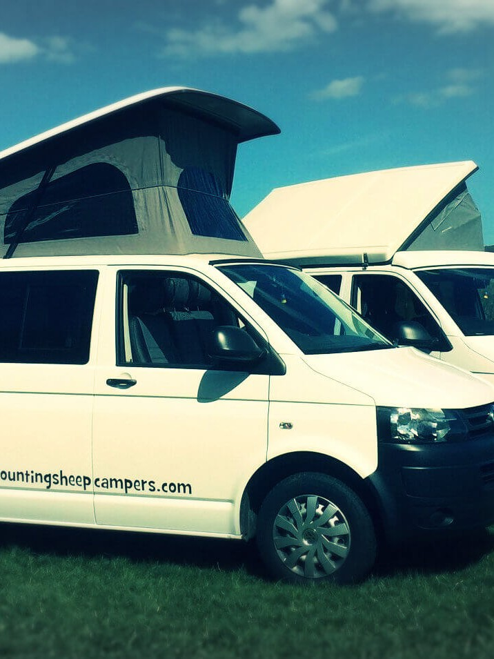 opt sandy in field campervan hire