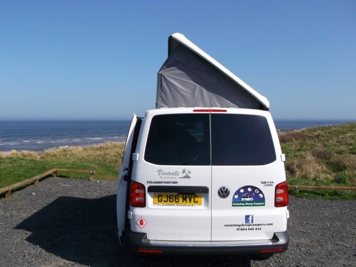 rear sandy roof up at beach camper van hire