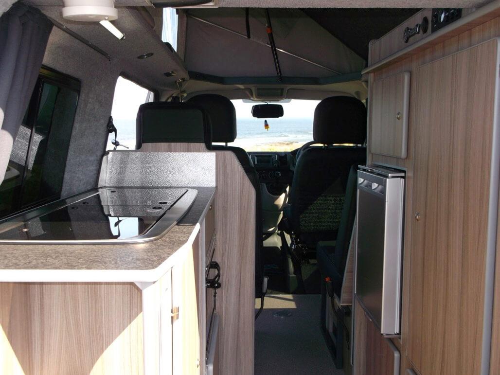 through back door of sandy camper van rent