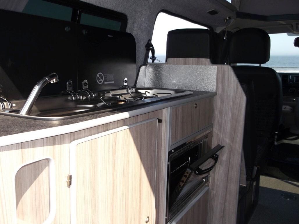 rear kitchen sandy camper van rent