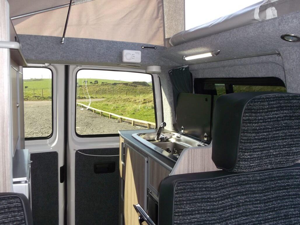 inside sandy with roof up camper van rent