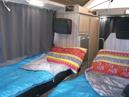 sleeping in sandy camper van