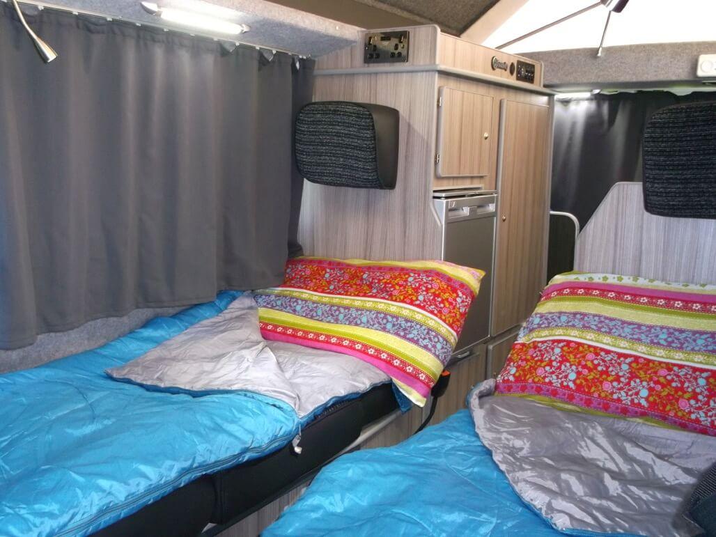 sleeping in sandy camper van