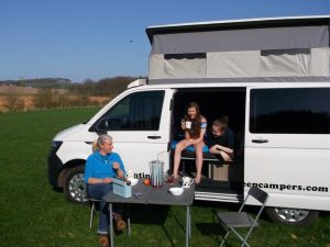 having a cup of tea outside sandy camper van hire
