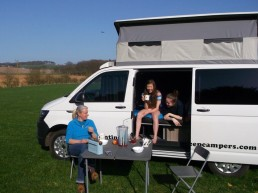 having a cup of tea outside in sandy the campervan we hired from counting sheep campers