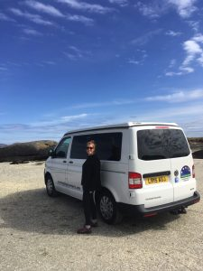 at the beach with pebbles and customer motorhome hire