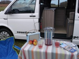 picnic table and logo skye campervan hire