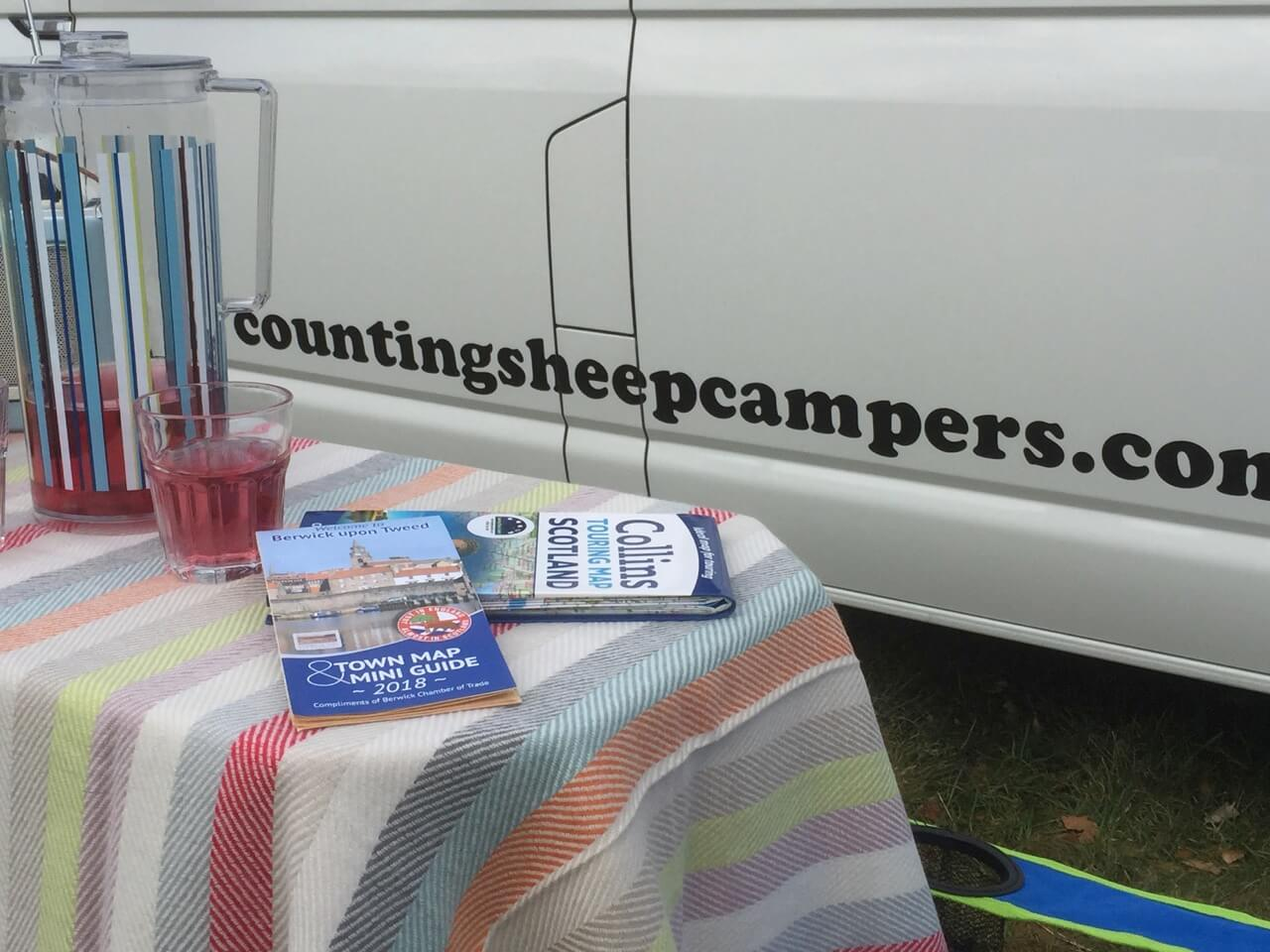 table and logo campervan hire
